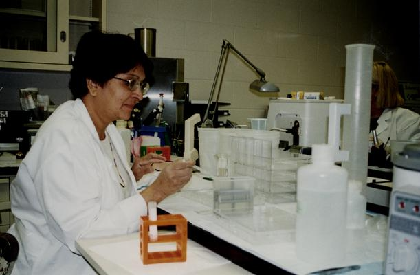 Female working in a College of Health Sciences laboratory