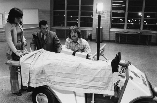 Carey, William J., Director of Emergency Services, University Hospital, pictured with Marilyn Schmidt (left) and Steve Gambaro (right), demonstrating emergency cart