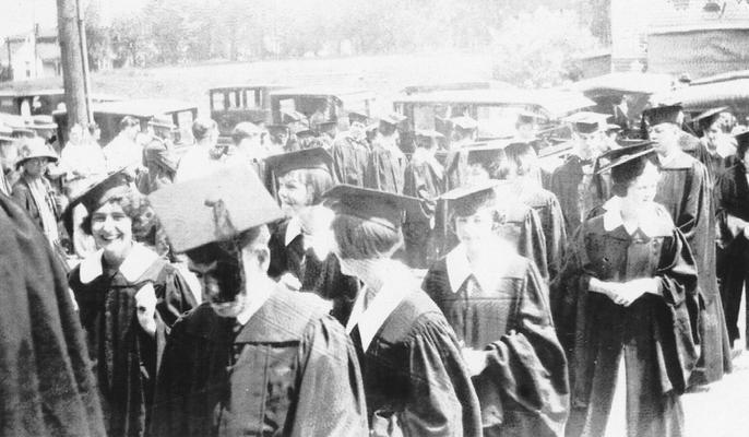 Carrol, Elizabeth (Betty), Alumna, pictured at graduation, smiling at right