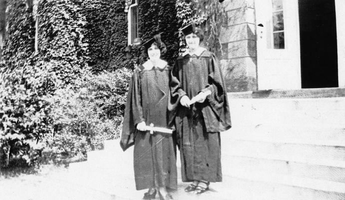 Carrol, Elizabeth (Betty), Alumna, pictured (left) with unidentified friend at graduation