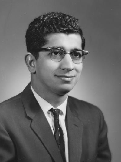 Chapra, M. Ulmer, Professor of Economics