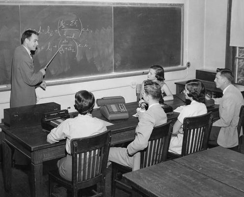 Christian, Virgil, Professor, Economics, pictured teaching a class, Public Relations Department
