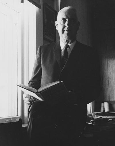 Clark, Thomas D., Alumnus, Master of Arts, 1929, Distinguished Professor, History Department, 1931 - 1968, Noted author and historian, Expert on Kentucky and Southern culture, pictured in office (probably in Frazee Hall), Public Relations Department photograph