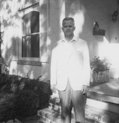 Clay, Maurice Alton, Professor, Physical Education, Coordinator, Undergraduate Professional Physical Education, 1940? - 1976, Alumnus, Ph. D., 1955, Executive Director of Omicron Delta Kappa national college leadership honor society, Former president of the UK Faculty Club, Board of Spindletop Hall, pictured in front of home