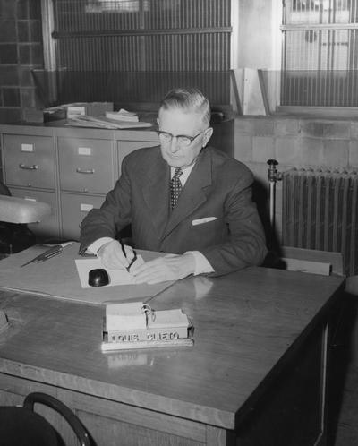 Clifton, Louis, Director, Department of University Extension, Public Relations Department, featured in 1957