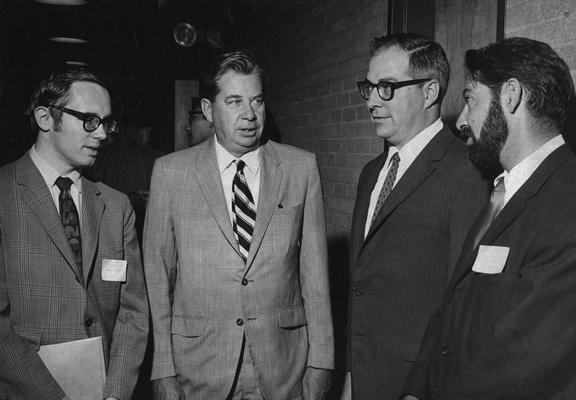 Cochran, Lewis W., Professor, Chemistry Department, Vice President for Academic Affairs, pictured second from left with Gary Christian, Galen Frysinger, Henry Bauer, attending a conference sponsored by the Graduate School, Public Relations Department
