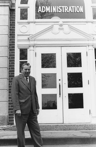 Cochran, Lewis W., Professor, Chemistry Department, Vice President for Academic Affairs, pictured in front of Administration Building