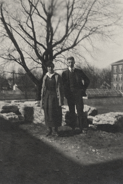 An image of Margaret Ingels and an unidentified man standing beneath a tree near some greenhouses. This image was found pasted on the front of page 103 of