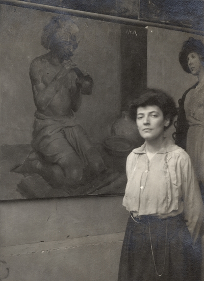 A portrait of an unidentified woman standing beside a painting of a man playing a musical instrument. This image was found pasted to the front of page 101 of the