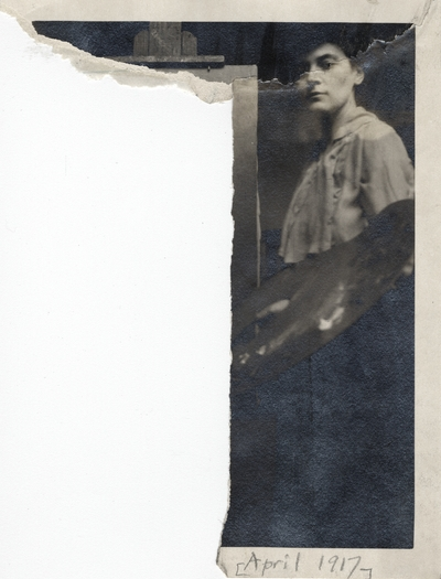 A damaged portrait of an unidentified woman standing next to a canvas. This image was found pasted to the front of page 101 of the