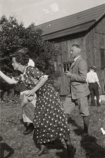 An image two men and two women outside near a barn. Margaret Ingels is in the action of throwing something. Christopher Schrader