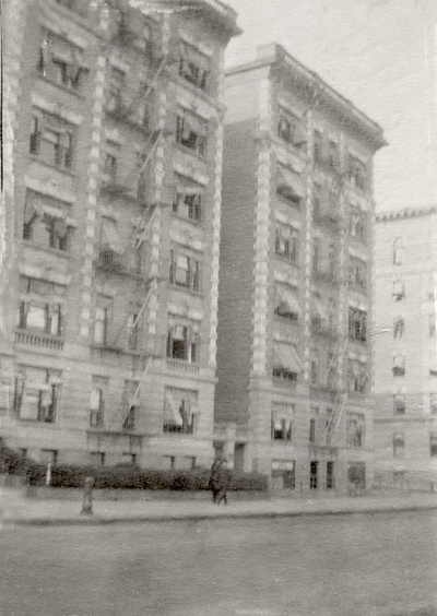 An image of seven story apartment building, with a note on the back of the print that says,