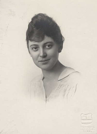 A portrait of an unidentified lady by Browning Fairfield of Iowa. This image was found pasted on the back of page 107 of