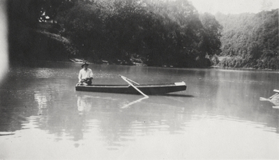 An image of an unidentified man in a canoe. This print was found pasted to the front of page 113 of
