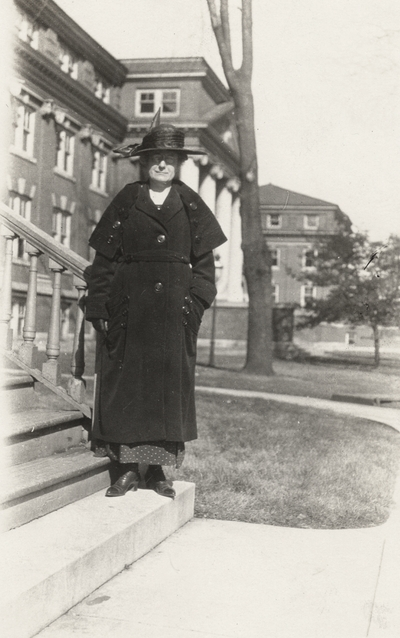 A portrait of [Eliza] Church standing on the steps of a building. This print was found among the