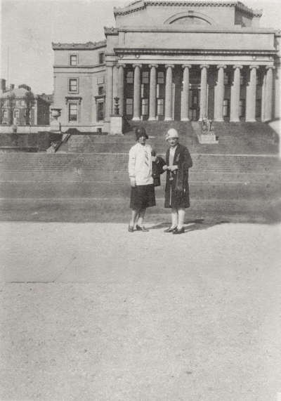 An image of two unidentified women standing in front of the Columbia University's Library