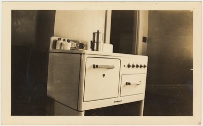An image of a light colored stove in a room