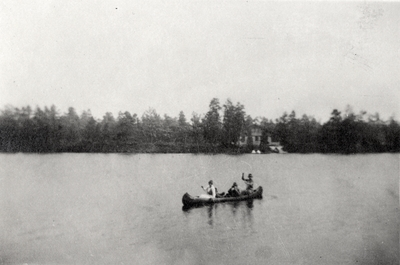 An image of three women in a canoe and writing on the print that says,