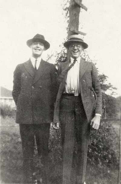 A portrait of two people standing in front of a tree. This print was found pasted to the back of page 109 of