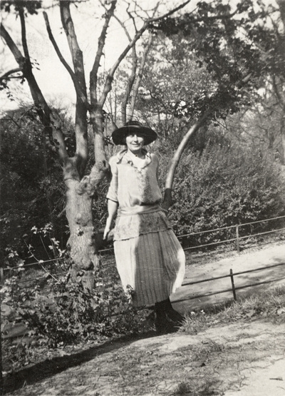 A portrait of Margaret Ingels leaning on a tree branch. This print was found pasted to the back of page 109 of