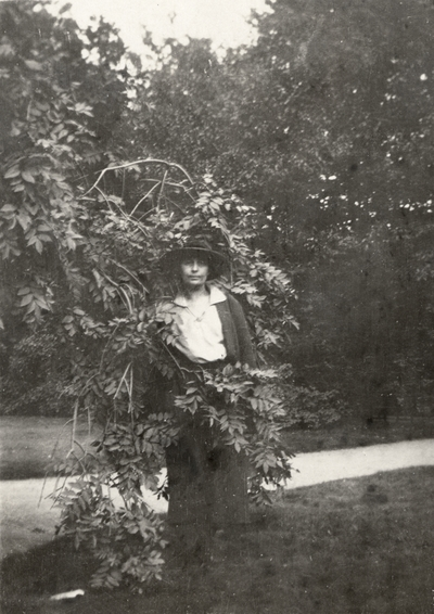 A portrait of Margaret Ingels standing in the branches of a tree. This print was found pasted to the back of page 109 of