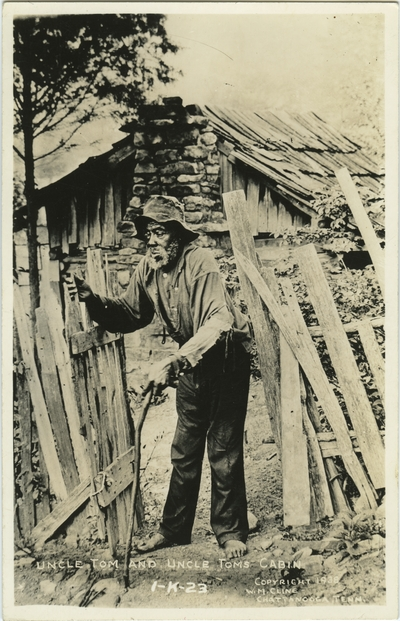 A postcard picturing Uncle Tom and his cabin; caption on postcard: