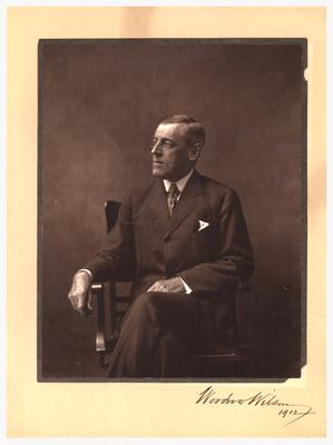 Portrait of Woodrow Wilson, sitting in a chair, autographed and dated: