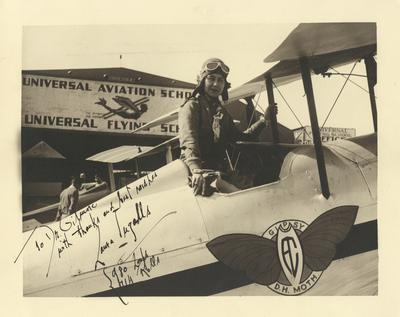 Portrait of Laura Ingalls in an airplane, autographed