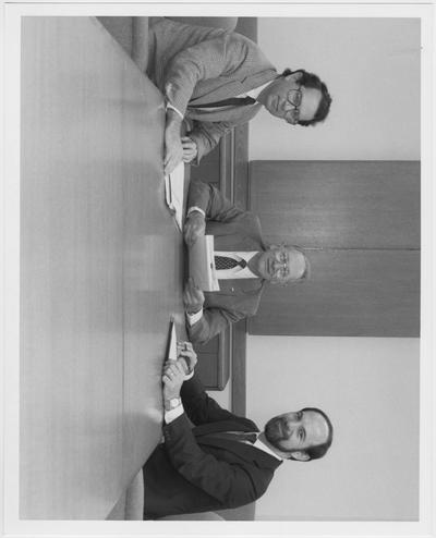 From left to right: Lee Saperstein, Chair of University of Kentucky Engineering; Raymond A. Bradley, Martin Company Coal Corporation; Thomas W. Lester, Dean of the College of Engineering; Photos for 1991 Coal Journal ad series about the University of Kentucky Mining Engineering Department
