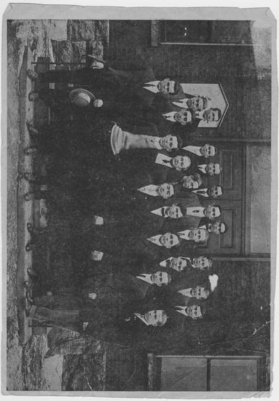 Members of the student branch of the American Institute of Electrical Engineers or of the American Society of Mechanical Engineers stand in front of Mechanical Hall; This image is on page 238 of the 1912 Kentuckian