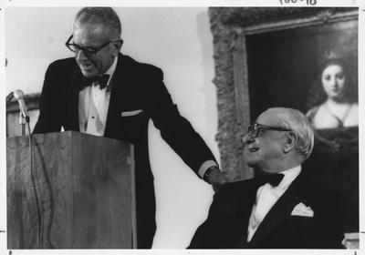Armand Hammer, right, listens to President Otis Singletary, left, speak at the opening of the Armand Hammer exhibit in the Art Museum in the Singletary Center