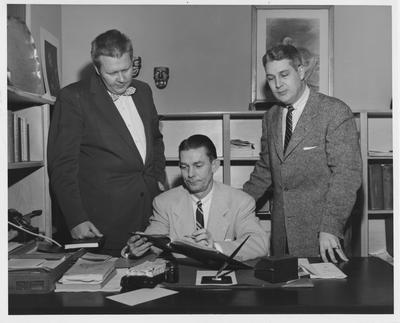 From left to right: Aimo Justus Kiviniem, Wallace Neal Briggs, and Ed Henry in Professor Briggs' office