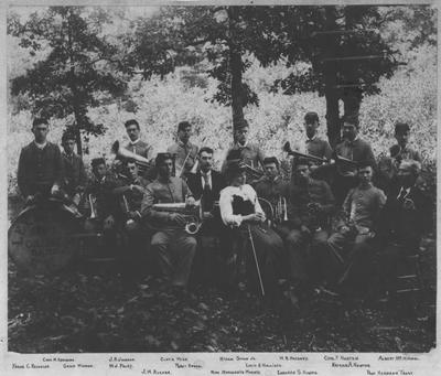 Lexington State College Band; From left to right, Back Row: Charles W. Abrahams, J. R. Johnson, Curtis Wise, Hiram Shaw, Jr., W. R. Hackney, Charles F. Norton, and Albert McMichael; Middle Row: Frank C. Reynolds, Genie Wieman, W. J. Foley, Percy Kendal, Louis H. Mulligan, Nathan A. Newton; Front Row: J. W. Rucker, Marguerite Wuertz, Leonard S. Hughes, and Professor Hermann Trost