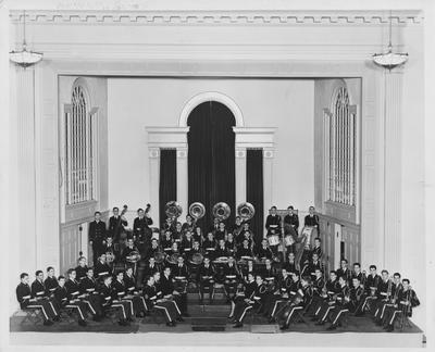 Concert band under director C. V. Magurean; This image is on page 220 of the 1941 Kentuckian; Photographer: LaFayette Studio