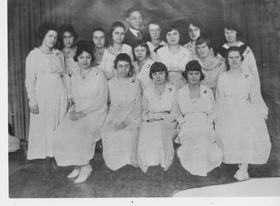 Girls Glee Club with Professor Carl Lampert; Lexington Herald - Leader staff photo