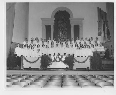 University choristers at a Christmas concert; This image is on page 136 of the 1957 Kentuckian