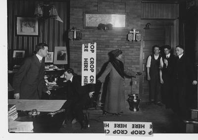 A rehearsal of a theater production; This image is on page 40 of the 1965 Kentuckian