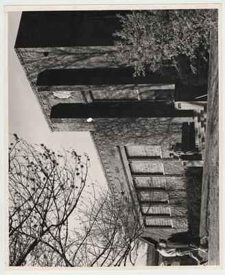 Lafferty Hall, the Law building, with Henry Neal standing on the steps