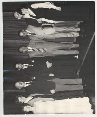 Chancellor Peter Bosomworth (third from left), Josie Bosomworth (second from left), and six unidentified; Photographer: Rubio Salazar
