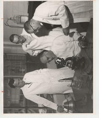 Bacteriology or Microbiology; Dr. Scherago seated