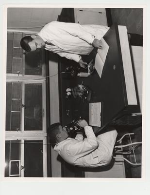 Pharmacy students using microscopes