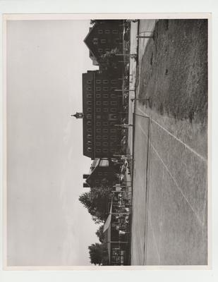 Men practice on the tennis courts in front of the men's dorms; Photographer: W. E. Sutherland