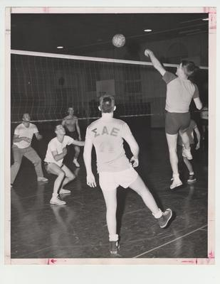 Men playing volleyball; Photographer: Ted W. Simmons