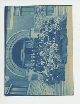 Women sit in front of the Gillis Building