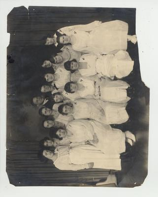 Girls' Glee Club; Includes (not in place order): Josephine Evans, Elizabeth Allen, Mary Lyons, Betty Brown, Elizabeth Bertram, Geneva Rice, Lucille Hendrix, Sara Metcalf Piper, Laura Lee Robertson, Lucille Blatz, Elsie Rache, Marian Kincheloe, Genieve Wells, Mrs. Clarence Gaugh, Sally Burns, Mary Anna Dev, Edna (Margaret) Smith (Mrs. Tom Borden), Katherine Reed, Georgia Lee Murphey, Mary Hardy Ligon, Mary Archer Bell, and Elizabeth Cook (pianist); Margaret Smith (Mrs. Tom Borden) is marked # 15); This image is on page 213 of the 1920 Knetuckian