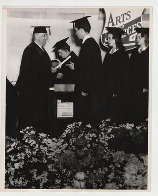 Arts and Sciences students at the 1947 commencement; Dean Paul P. Boyd, left; Photographer: W. E. Sutherland