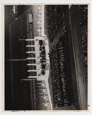 Commencement ceremony on Stoll field; Photographer: W. E. Sutherland
