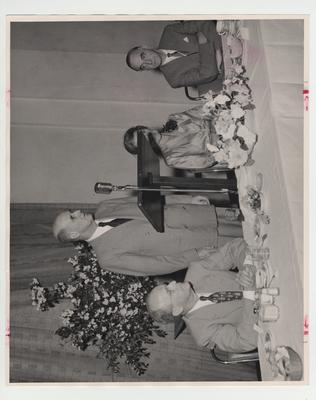 From left to right: Vice - President Dr. Leo M. Chamberlain, Louis Ware, speaker Mrs. Paul Blazer, and an unidentified man
