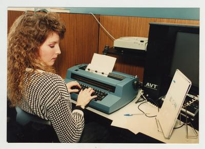 A female student types at Ashland Community College