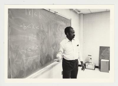 An African - American male professor teaches a Math class at Elizabethtown Community College